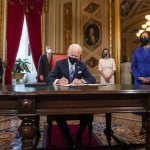 Biden rolls back Trump policies on wall, climate, health, Muslims