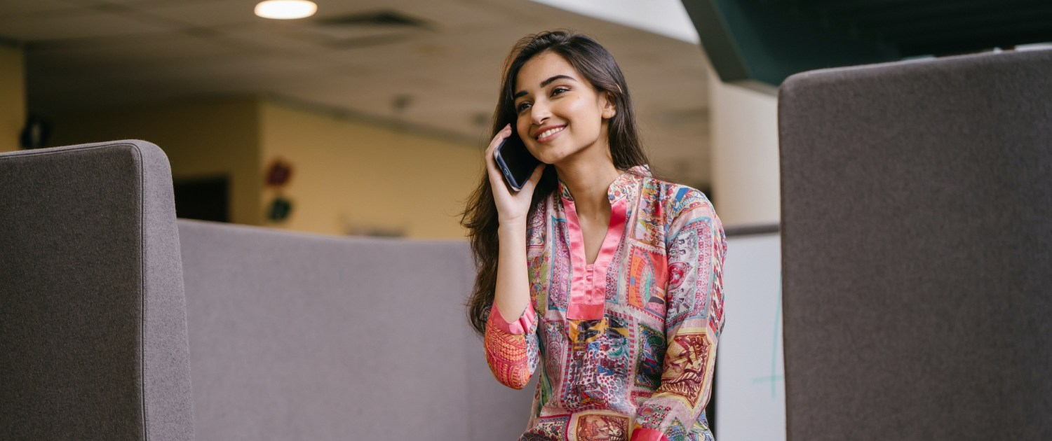 photo-of-smiling-woman-in-floral-salwar-kameez-talking-on-2559055