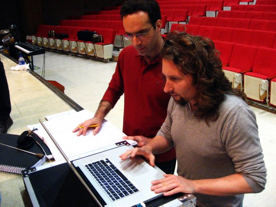 Before full rehearsal, Conductor Itay Dvori and Composer Marco Hertenstein compare notes. (PHOTO: Charles Ian Chun)