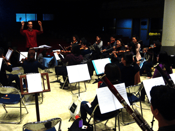Conductor Itay Dvori leads the 40-piece orchestra through rehearsal the day before the concert. (PHOTO: Charles Ian Chun)