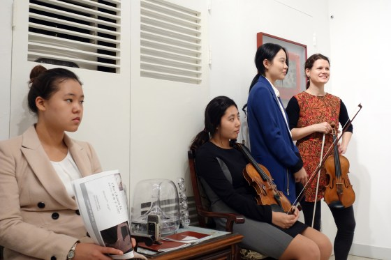 German School of Music Weimar violin professor Viktoria Kaunzner and her students perform at a reception for artist Francesca Cho, Gallery Art Plaza, Seoul. 30 October 2013. (Photo: Charles Ian Chun)