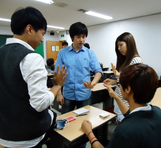 Entrickcian president Bae Sung-man teaches a magic trick to members of Entrickcian. (from left Nam Jin-woo, Bae Sung-man,  Kim Ga-hyun, Roh Sung-hyun) (PHOTO: Bikash KC)