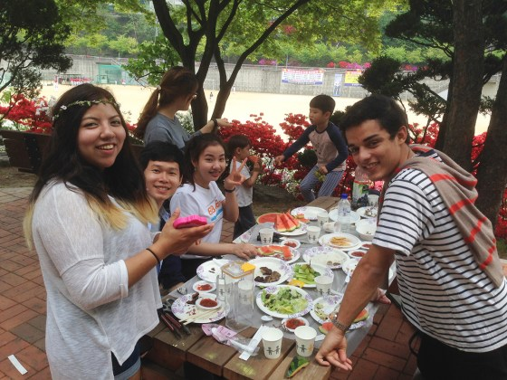 Members of Kangnam University's international community took advantage of the sunny weather Saturday afternoon to enjoy a picnic with KNU English Ministry preacher Erik Turkelson in front of Insa Hall. (Photo: Erik Turkelson)