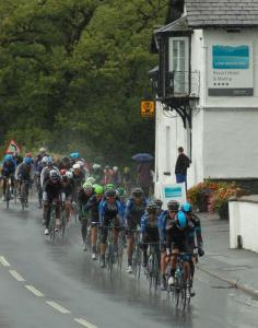 The peloton passing Low Wood Bay