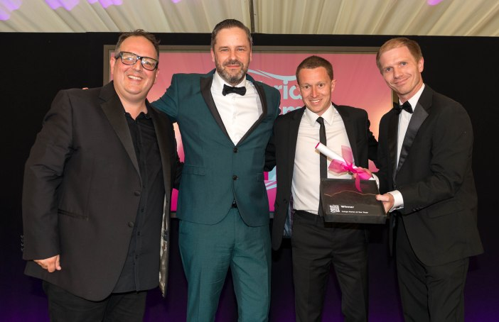 CUMBRIA TOURISM AWARDS 2016 --- Large Hotel of the Year winner - Waterhead Hotel, Ambleside. (l-r) Justin Moorhouse, Matt Stanaway, Anthony Sutcliffe, and award sponsor Richard Andrew of Armstrong Watson. // Annual award ceremony from Cumbria Tourism celebrating the best in the county's tourist attractions. Held at Cartmel Racecourse and hosted by comedian Justin Moorhouse. Wednesday 22nd June 2016. HARRY ATKINSON