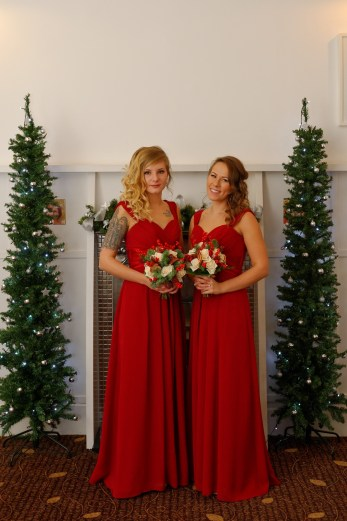 Claire's bridesmaids, beautifulred dresses hair styled by Shelley Gibson.