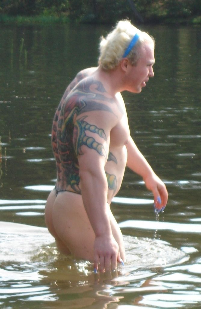 strange bodybuilder was spotted on the lake shore 5
