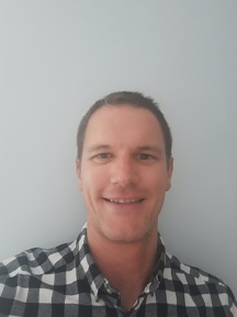 Head and shoulders image of Craig in a blue and white chequered shirt.