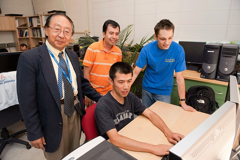 Dr. Gao with students in an Evans Hall lab from 2010.