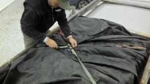Tying down the tarp.