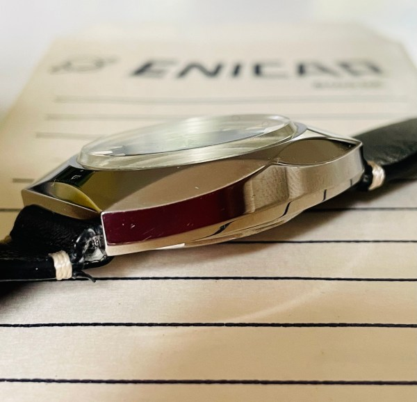 Enicar blue dial watch side