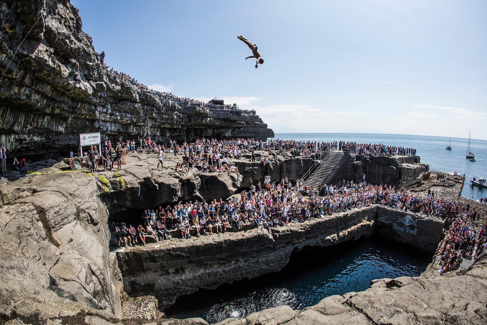Steven Lobue of the USA dives from the 28 metre platform during the  third stop of the Red Bull Cliff Diving World Series, Inis Mor, Aran Islands, Ireland on June 29th 2014. // Romina Amato/Red Bull Cliff Diving // P-20140629-00123 // Usage for editorial use only // Please go to www.redbullcontentpool.com for further information. //