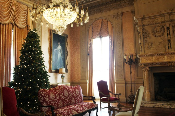 "Rosecliff Mansion - Newport RI | The Salon, decorated with a lighted Christmas tree amidst French Renaissance decor, was a comfortable receiving area for the lady of the house's guests. Here, a working, carved Gothic fireplace provided ambiance as well as heat in addition to the mansion's central heating. A large portrait of the home's hostess, Theresa ""Tessi"" Oelrichs, oversees the room."