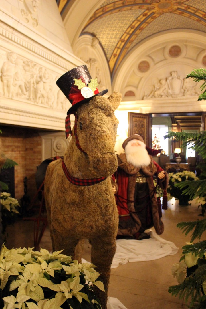 The Breakers - Newport RI | A vintage stuffed horse and an old-fashioned Saint Nicholas at The Breaks bring good cheer to children visiting The Newport Mansions at Christmas.
