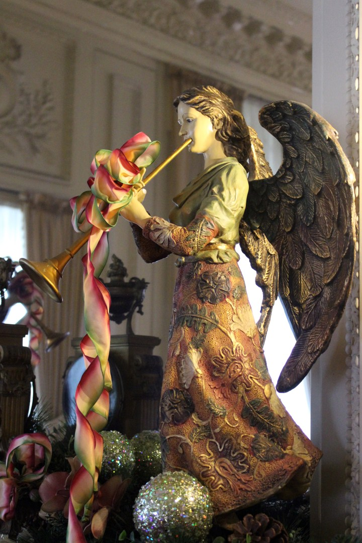 The Breakers - Newport RI | A vintage angel heralds the Christmas Season atop one of many festive fireplace mantels at The Breakers.