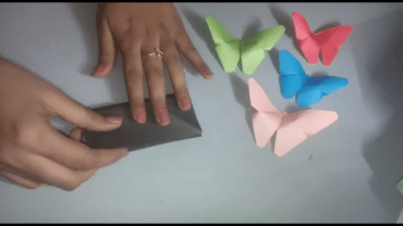 Fold the paper vertically