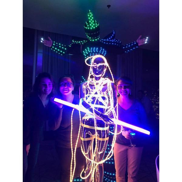"More Lighting After Dark fun: enLIGHTenment's Nicole Davis (left), Bulbrite's Martha Delgado (center) and Kareen Stephens pose with a ""light"" mannequin."