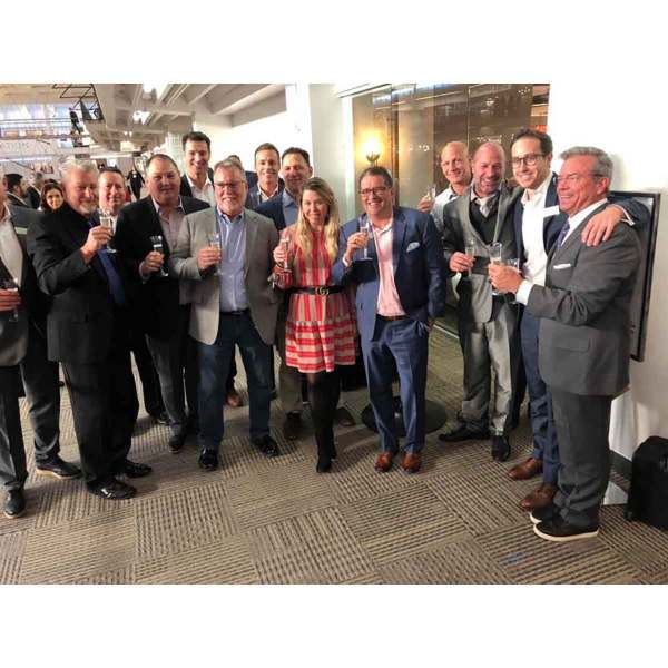Quoizel celebrated its 90th anniversary with a champagne toast at market