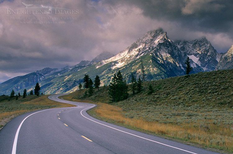 Photo: Curving road below mountain range dusted by first snow of fall, Grand Teton National Park, Wyoming