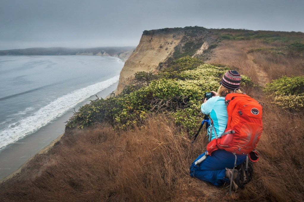 Photo: Photographer shooting the cliffs of Drakes Bay during a photo workshop at Point Reyes National Seashore, Marin County, California