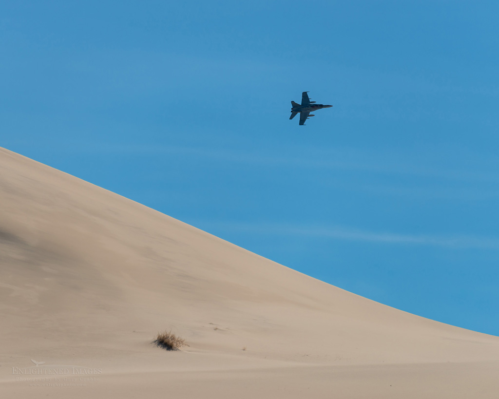 Photo: F-18 Hornet jet flying over Eureka Sand Dunes, Death Valley National Park, California