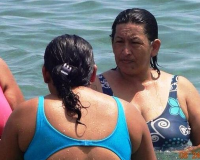 [FOTOS] Dicen que Hugo Chávez reencarnó en una mujer y viralizan imagen