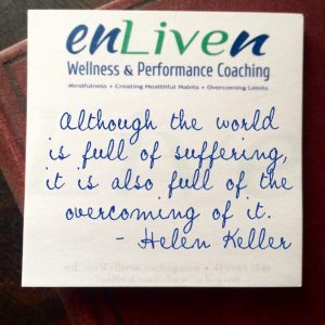 "Quote from Helen Keller on an Enliven Wellness Coaching sticky note reading, ""Although the world is full of suffering, it is also full of the overcoming of it."""