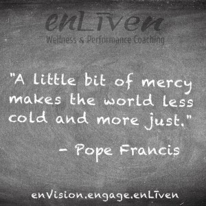 "Pope Francis quote on enLiven Wellness Coaching chalkboard reading, ""A little bit of mercy makes the world less cold and more just."""