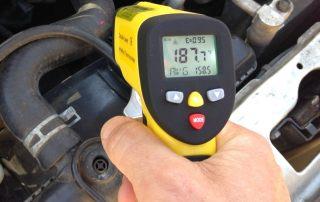 automotive diagnostics: measuring coolant temperature in car with temperature gun eT650D