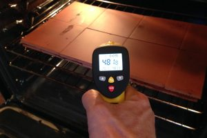 measuring oven pizza stone or tile temperature with the ennoLogic infrared thermometer in the kitchen for that perfect pizza