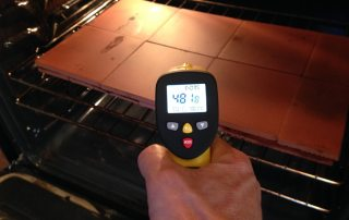 measuring oven pizza stone or tile temperature with eT650D infrared thermometer in the kitchen for that perfect pizza