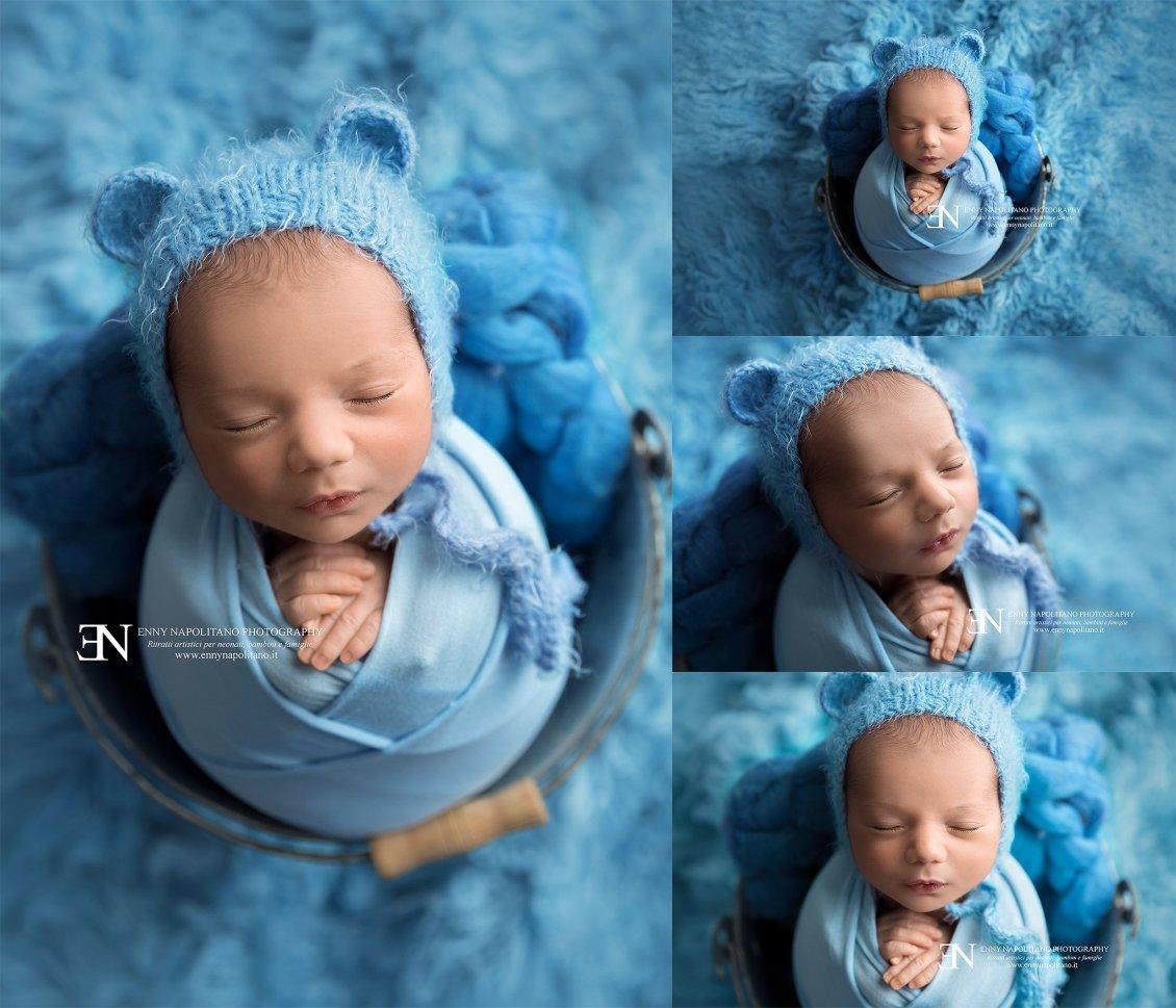 fotografia di neonato fasciato dentro un secchio servizio fotografico per neonati e bambini newborn