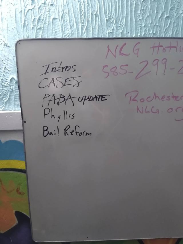 The agenda on the whiteboard says, Intros, cases, PABA update, Phyllis, and bail reform.