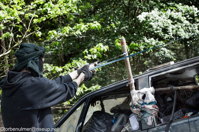 fights about the eviction of barricades on 26/04/2018. Zadist firing sling shot in the direction of the gendarmerie
