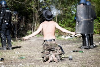 fights about the eviction of barricades on 26/04/2018. Zadist kneeing topless in front of gendarmerie screaming at them