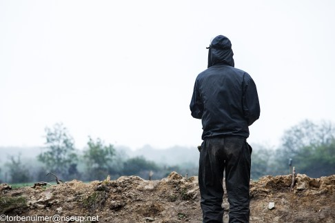 fights about the eviction of barricades on 27/04/2018. Zadist standing at an open field observing the movements of the gendarmerie