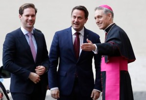 Luxembourg's Prime Minister Xavier Bettel is welcomed by Prefect of the Pontifical household Georg Gänswein as he arrives at the Vatican for a meeting with Pope Francis, Friday, March 24, 2017. Leaders of EU and heads of EU institutions were received by Pope Francis ahead of an EU anniversary summit. (AP Photo/Alessandra Tarantino)