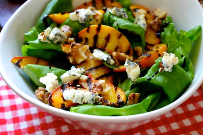 bowl of salada, grilled peaches, nuts and French Blue cheese salad, wine cheese & salt