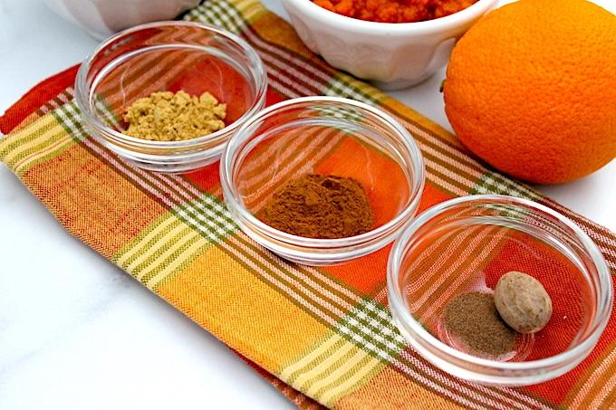 ginger, cinnamon, allspice, nutmeg and orange, ingredients for the pumpkin spice loaf.