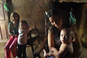 Darling Lacayo, 32, looks at one of her seven children during an interview 20 April, 2007 in San Martin neighbourhood in Managua. According to Lacayo, in Daniel Ortega's government first 100 days in power the situation for the poorest worsened. Lacayo shares the house with her mother and her sister and family -making a total of 15 people- and, at the very best, they altogether earn 3,8 US dollars a day to face up to their responsabilities. AFP PHOTO/Miguel ALVAREZ
