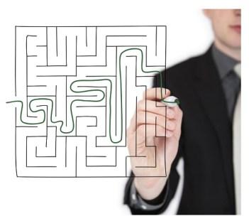 business-man-going-through-maze