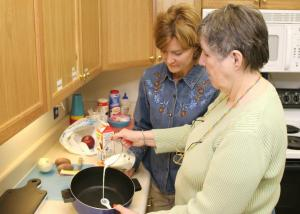 Cori, an OT, works on adaptive cooking skills and kitchen safety.