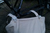 More thermoplastic makes clips to hold the pannier to the frame. The top hem now includes a bamboo strip to brace it.