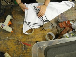 Hot-glueing fabric to the cable-tie ear skeletons