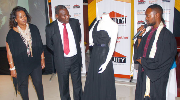 Sally Karago and Dr. Mwangi listen as Arnold describes his winning design