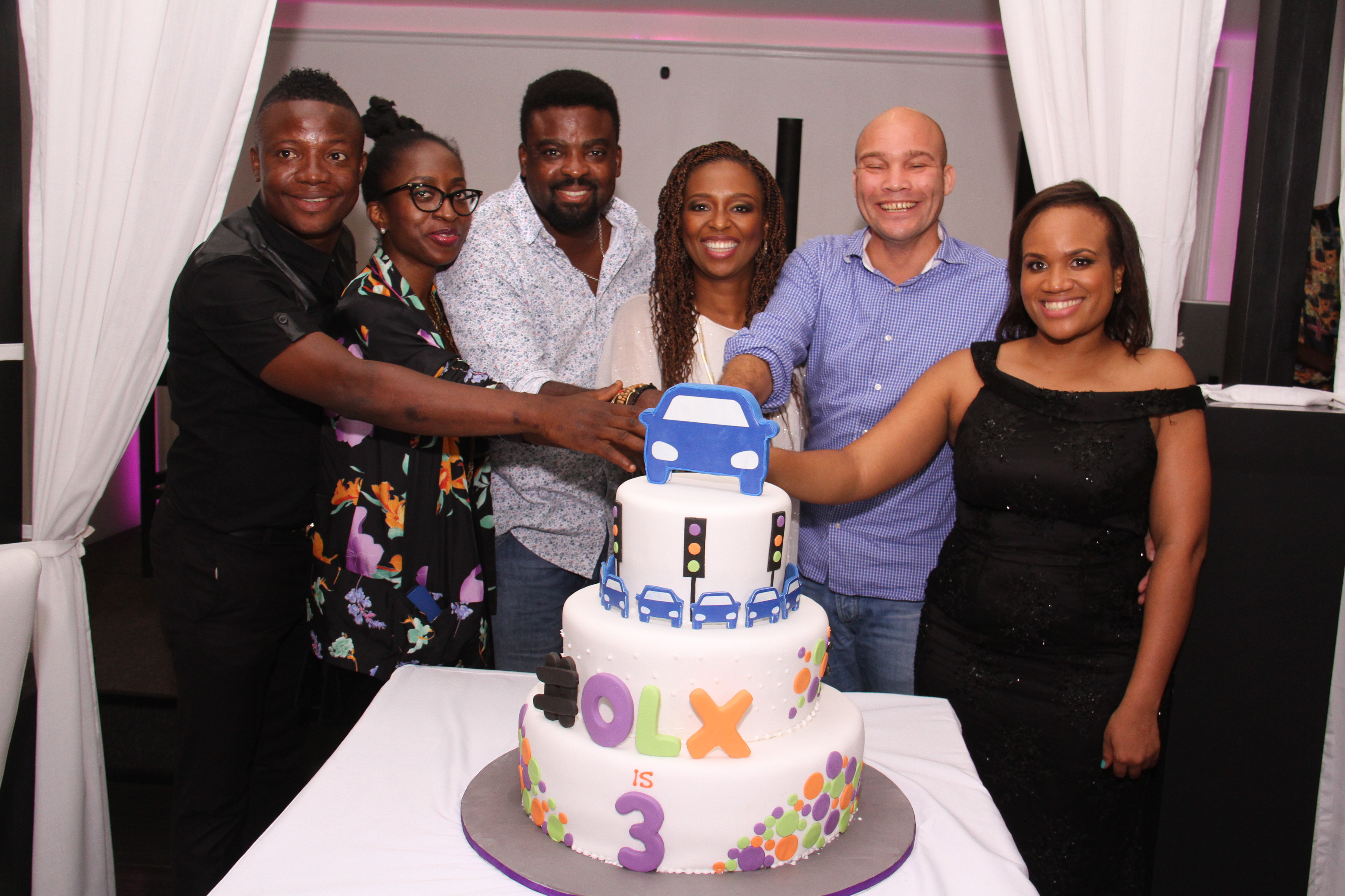 L-R Bash, Comedian & MC; Fife Aiyesimoju; Brand Marketing Manager, OLX; Kunle Afolayan; Nollywood Actor and Film Director; Lola Masha, Country Manager; OLX; Arthur Dieffenthaler; Commercial Director, Air France and Uche Nwagboso; PR & Communication Manager, OLX cutting the 3rd anniversary cake at the Rooftop Restaurant, VI.
