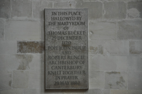 A plaque on the wall at the site of the murder