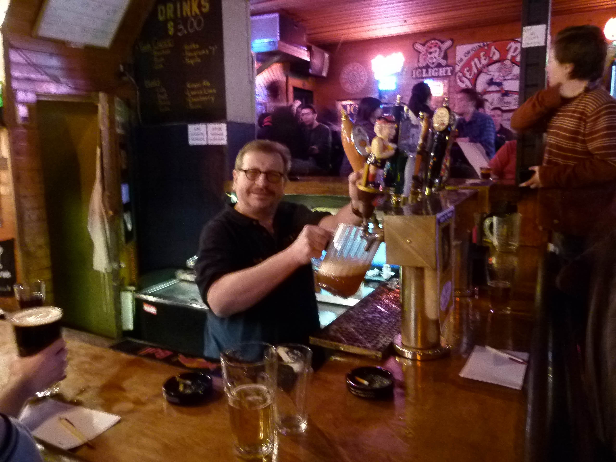 Affable owner/bartender Gene Ney pouring a pitcher from the tap.