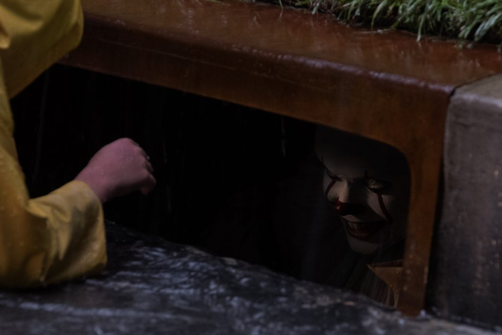 In looking for his paper sailboat Georgie Denbrough (Jackson Robert Scott) sees Pennywise in the sewer.