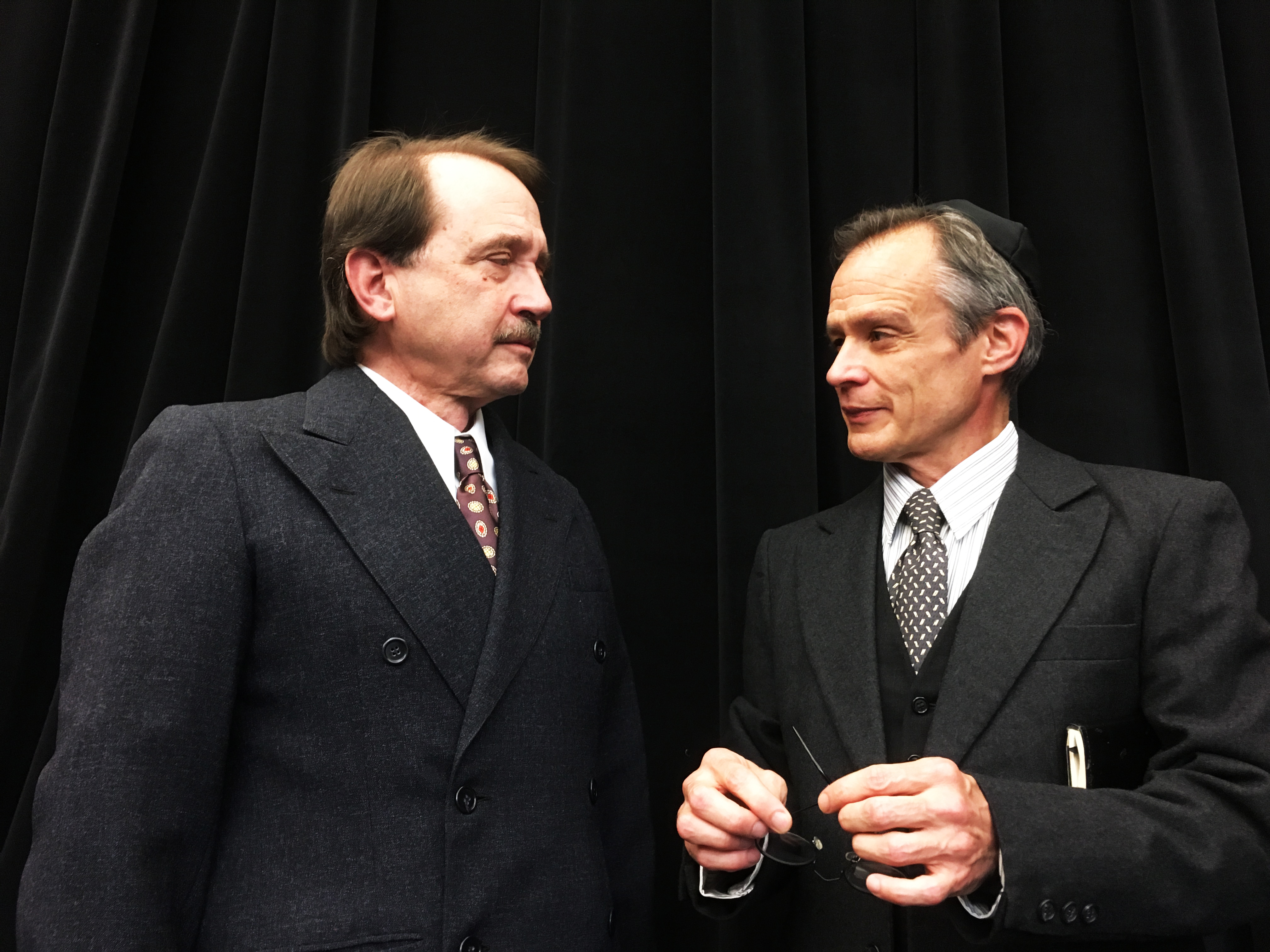 Antonio (Martin Giles, L) and Shylock (James FitzGerald) have a business relationship. Not shown: the monkey business that unfolds around them, and the ugly business that will soon erupt.